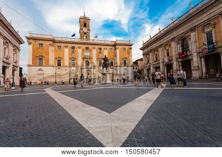 ROME ITALY - September 12 2016: Tourists visit Piazza del Campidoglio and Statue of Emperor Marcus Aurelius. Piazza del Campidoglio is famous square in central Rome designed by Michelangelo