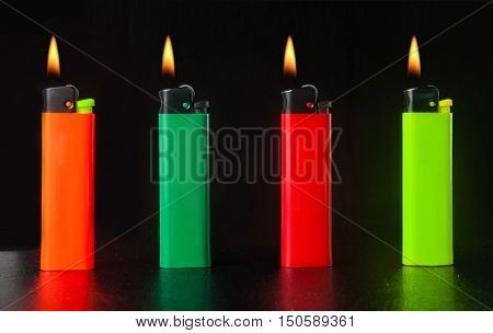 burning cigarette lighter on a black background