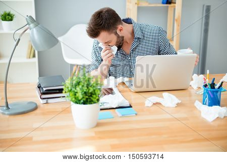 Sick Businessman With Temperature  Working In Office