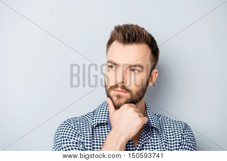 Portrait Of Serious Ponder Young  Man Touching Chin