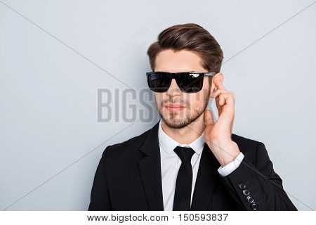 Portrait Of Handsome Young Security Guard In Black Glasses