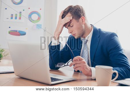 Overworked Young Man Having Headache After Hard Working Day