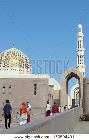 MUSCAT - DEC 25:Visitora at Al Qubrah Mosque on December 25 2012 in Muscat Oman.The Al Qubrah Mosque is the only mosque in Oman that allows tourists inside the complex