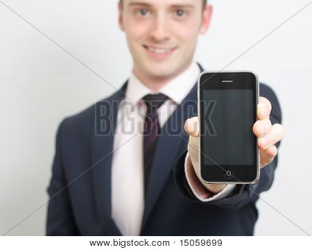 A business man showing his phone