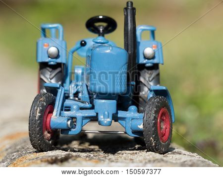a scale model of blue farm tractor