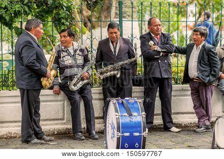 Banos De Agua Santa Ecuador - 23 June 2016: Men Orchestra Entertains The Citizen And The Tourists In Banos De Agua Santa In Front Of The Town Hall Ecuador South America