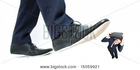 A business man about to step on an employee