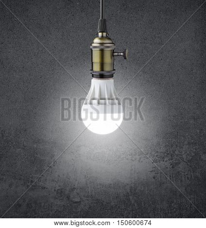 Glowing LED bulb on grunge  wall