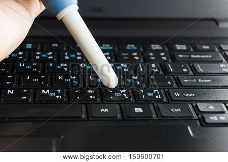 Young woman hands cleaning laptop computer screen.