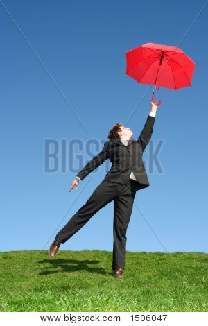 Businessman Outdoors Holding An Umbrella
