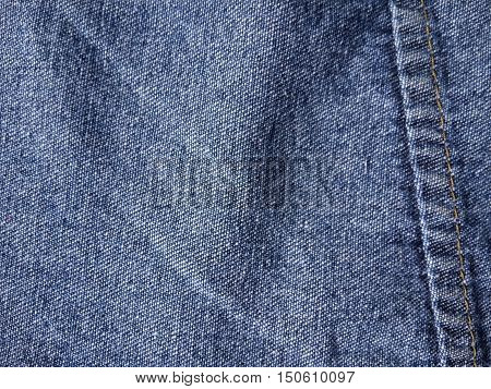 close up blue seam jean texture for background