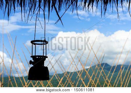 The old antique storm lanterns on blue sky