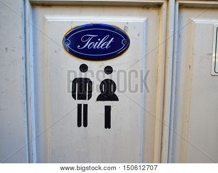 Old vintage classical style sign of public WC toilet