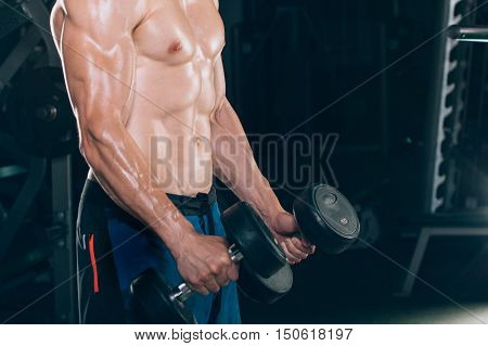 Muscle man doing bicep curls. Muscle man doing bicep curls.