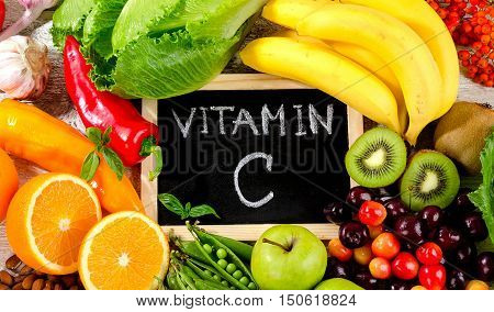 Foods High In Vitamin C On A White Wooden Background.  Healthy Diet Eating.