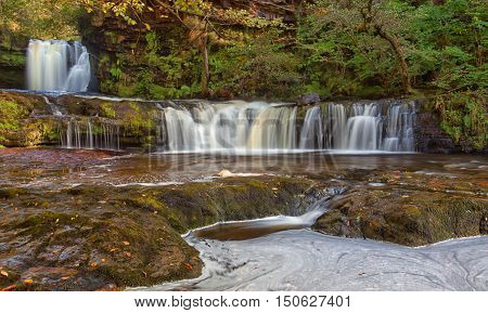 Autumn at Sgwd Ddwli Isaf waterfalls on the river Neath, near Pontneddfechan in South Wales, UK.