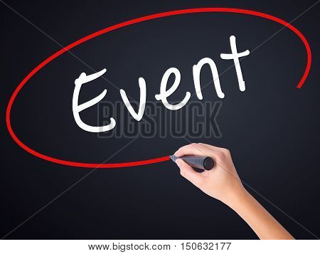 Woman Hand Writing Event With A Marker Over Transparent Board