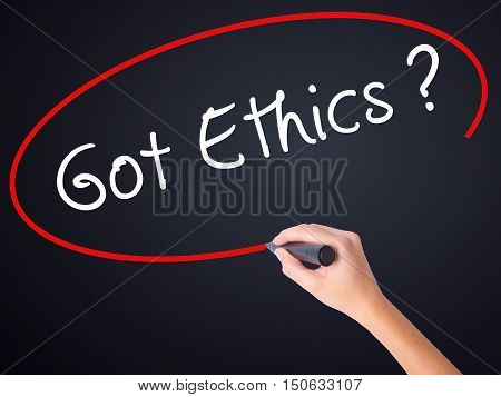 Woman Hand Writing Got Ethics With A Marker Over Transparent Board
