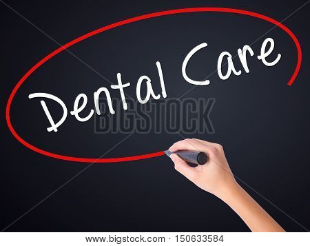 Woman Hand Writing Dental Care With A Marker Over Transparent Board