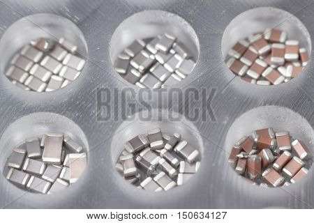SMD passive parts resistors and capacitors in plastic cells