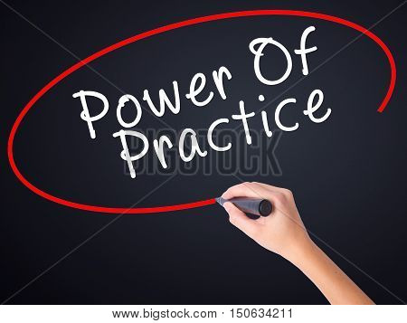 Woman Hand Writing Power Of Practice With A Marker Over Transparent Board