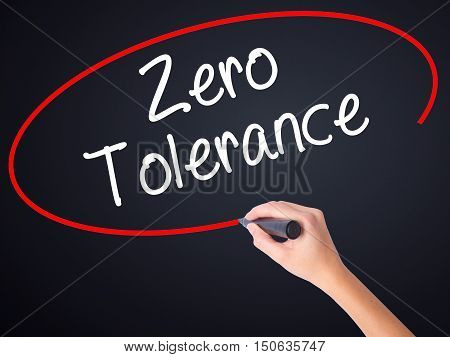 Woman Hand Writing Zero Tolerance With A Marker Over Transparent Board