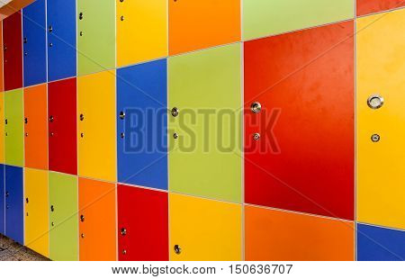 Wooden multi color painted school lockers in hallway
