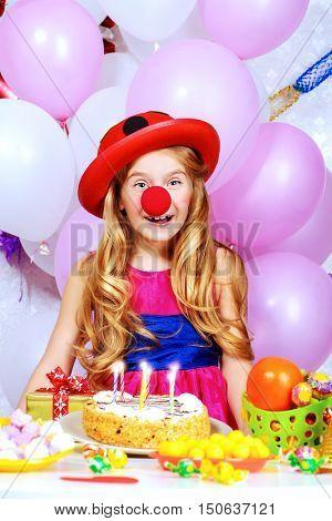 Cute happy child girl enjoys her birthday. Celebration, life events. Happy birthday.