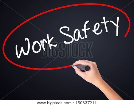 Woman Hand Writing Work Safety With A Marker Over Transparent Board