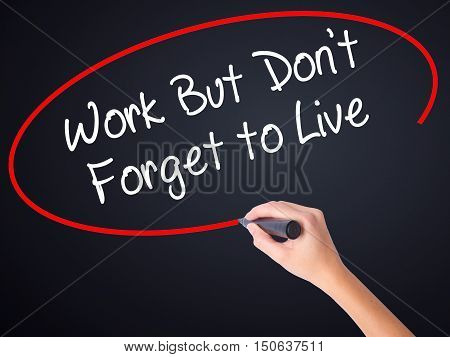 Woman Hand Writing Work But Don't Forget To Live  With A Marker Over Transparent Board