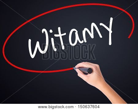 Woman Hand Writing Witamy (welcome In Polish) With A Marker Over Transparent Board .