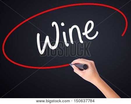 Woman Hand Writing Wine  With A Marker Over Transparent Board
