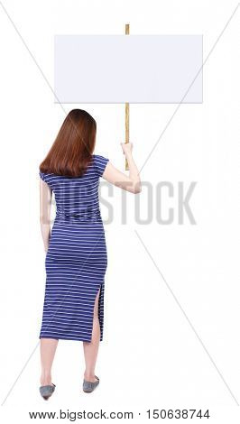Back view woman showing sign board. man holds information plate. Rear view people collection. backside view of person. Isolated over white background. The brunette in a blue dress holding a poster in