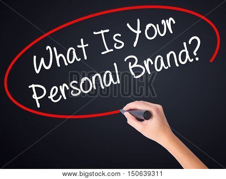 Woman Hand Writing What Is Your Personal Brand? With A Marker Over Transparent Board