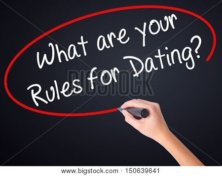 Woman Hand Writing What Are Your Rules For Dating?  With A Marker Over Transparent Board