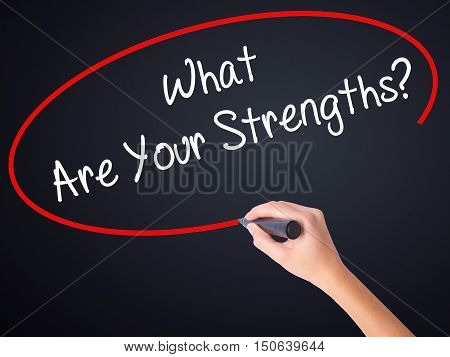 Woman Hand Writing What Are Your Strengths? With A Marker Over Transparent Board