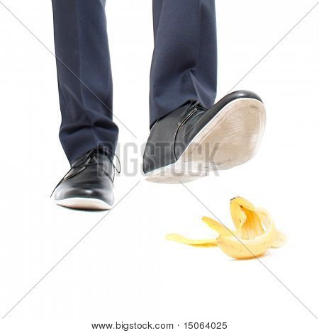 A banana peel and a man about to step in it