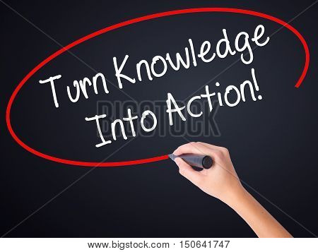 Woman Hand Writing Turn Knowledge Into Action! With A Marker Over Transparent Board