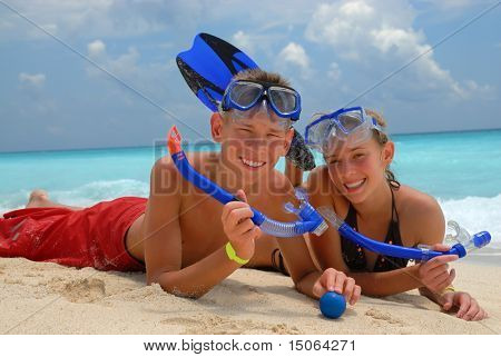 Happy snorkeling teens