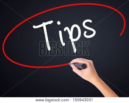 Woman Hand Writing Tips With A Marker Over Transparent Board