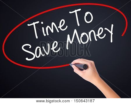 Woman Hand Writing Time To Save Money  With A Marker Over Transparent Board .
