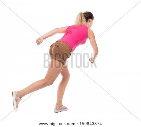 back view of running  woman. beautiful girl in motion. backside view of person.  Rear view people collection. Isolated over white background. The girl in brown shorts runs off to the side.