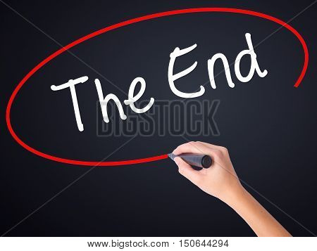 Woman Hand Writing The End With A Marker Over Transparent Board