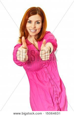 Young woman in pink dress thumb up
