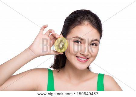 Kiwi fruit. Happy young asian woman holding kiwi fruit isolated on white background