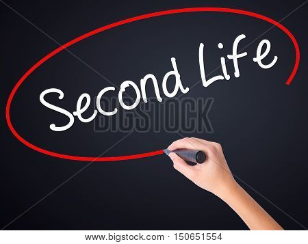 Woman Hand Writing Second Life With A Marker Over Transparent Board .