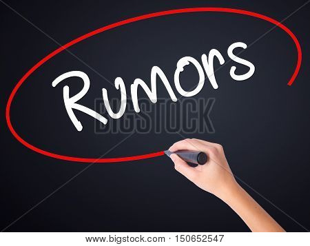 Woman Hand Writing Rumors  With A Marker Over Transparent Board .