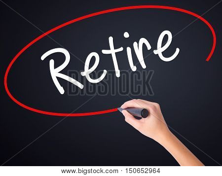 Woman Hand Writing Retire With A Marker Over Transparent Board