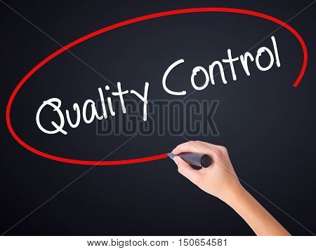 Woman Hand Writing Quality Control With A Marker Over Transparent Board