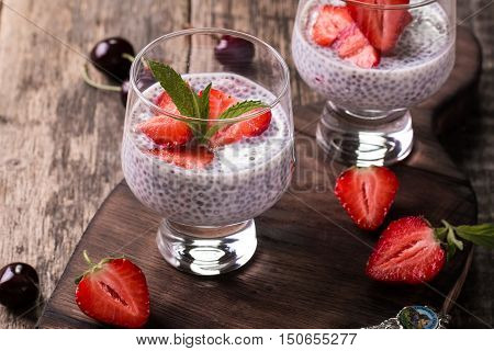 Chia Seed Pudding With Strawberries And Min On Wooden Vintage Background